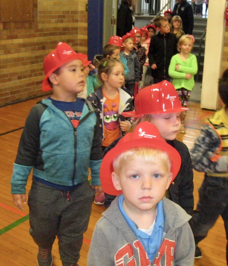 Students with fire hats.