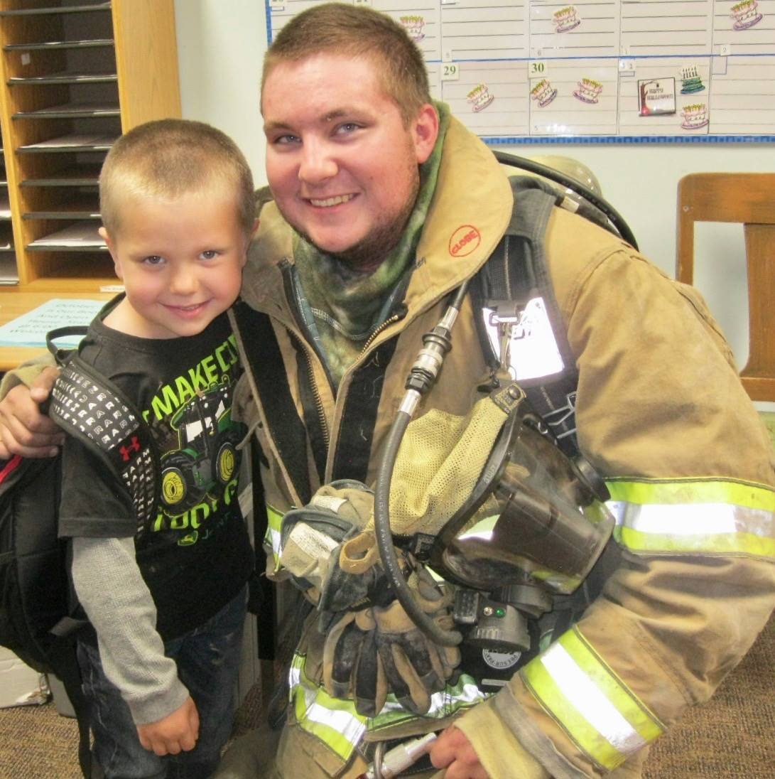 A firefighter and his son.