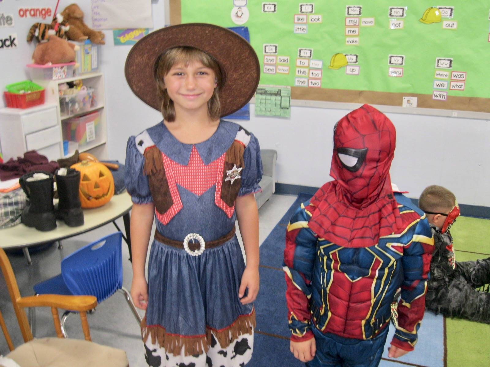 A cowgirl and spiderman