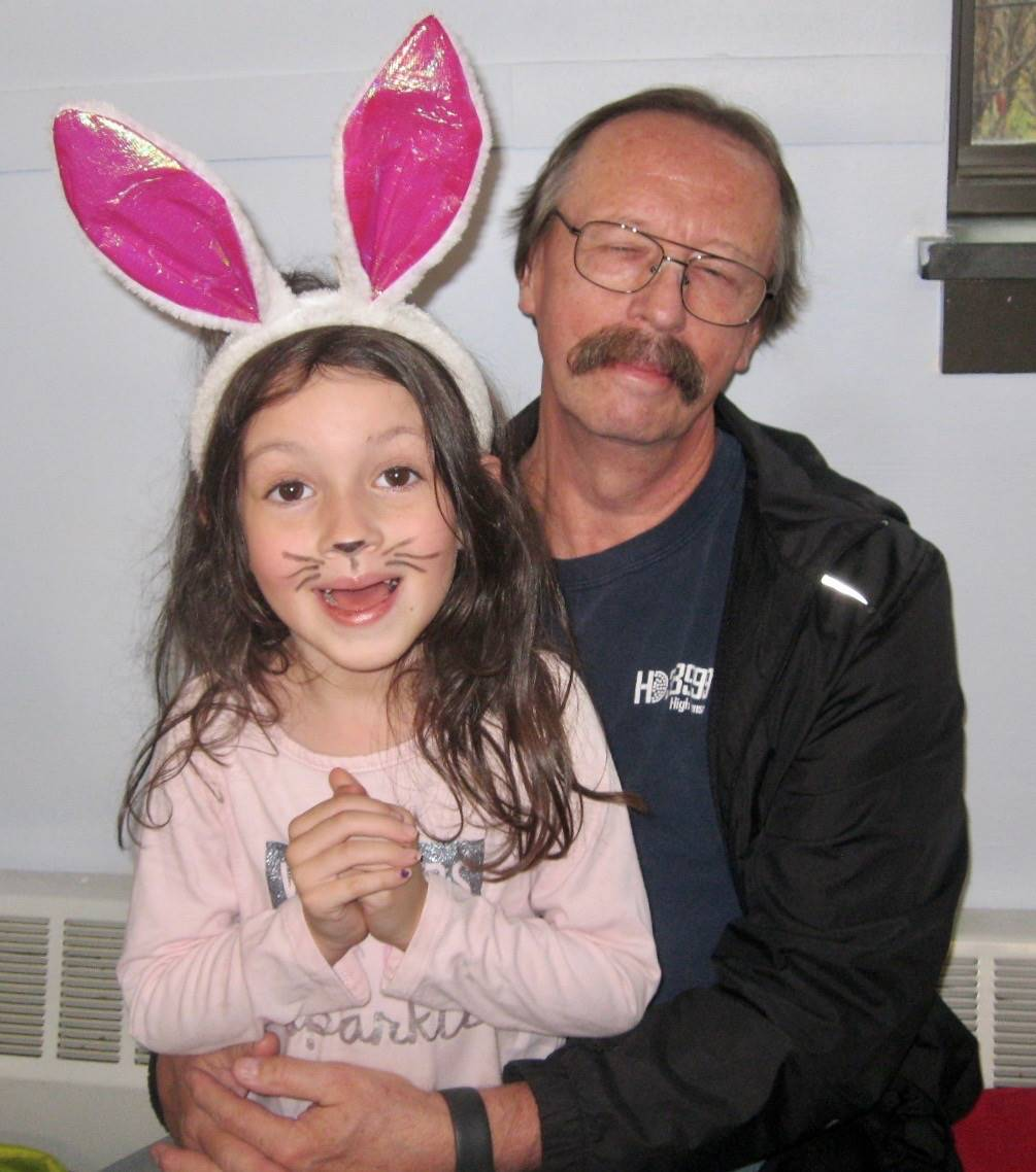"""A grandfather with is """"bunny"""" kid."""