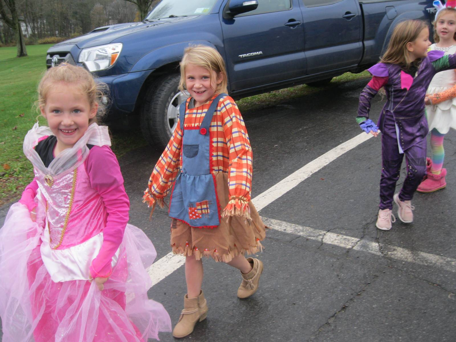 Students marching in halloween parade.