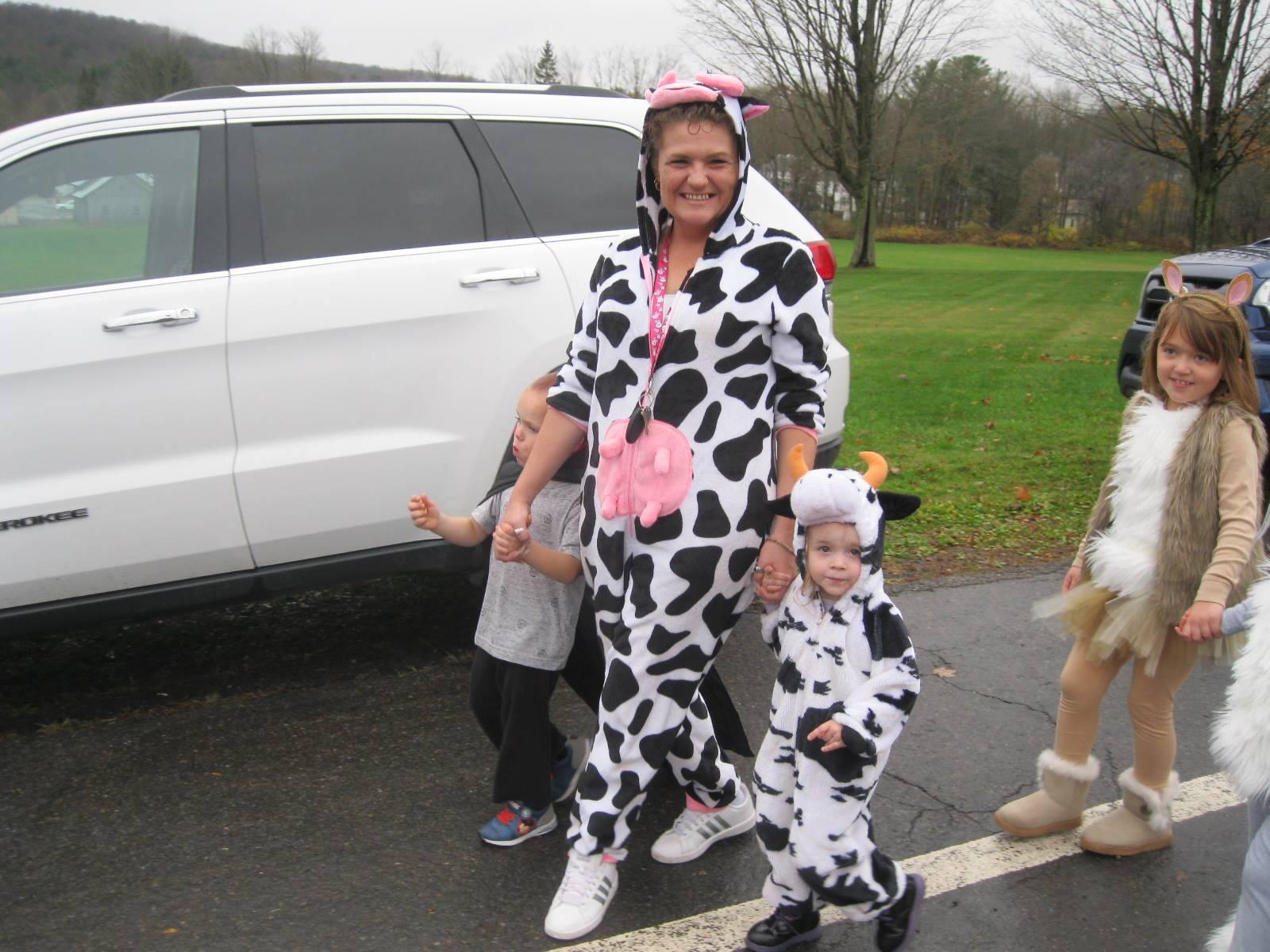 cows in halloween parade.