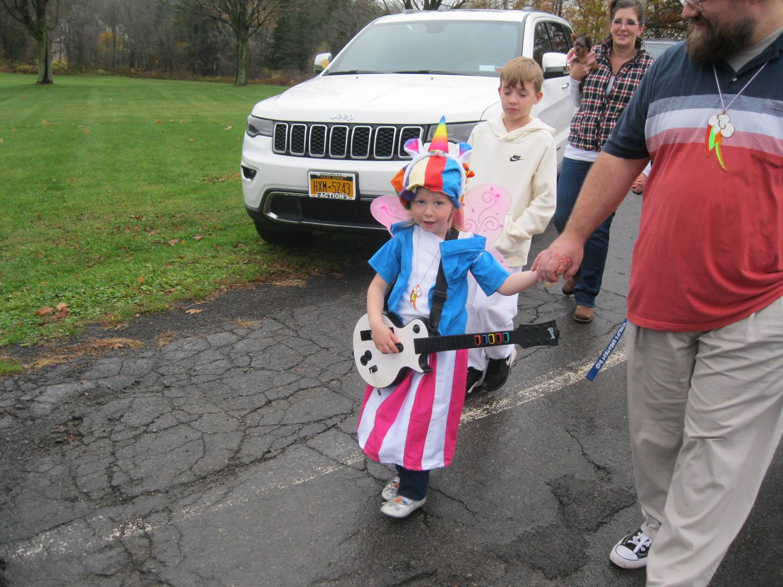 student banjo player marches in halloween parade