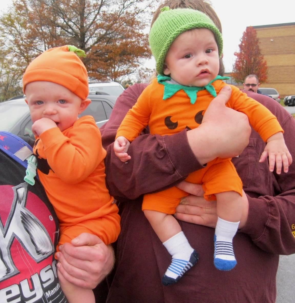 Babies dressed up as  pumpkins.
