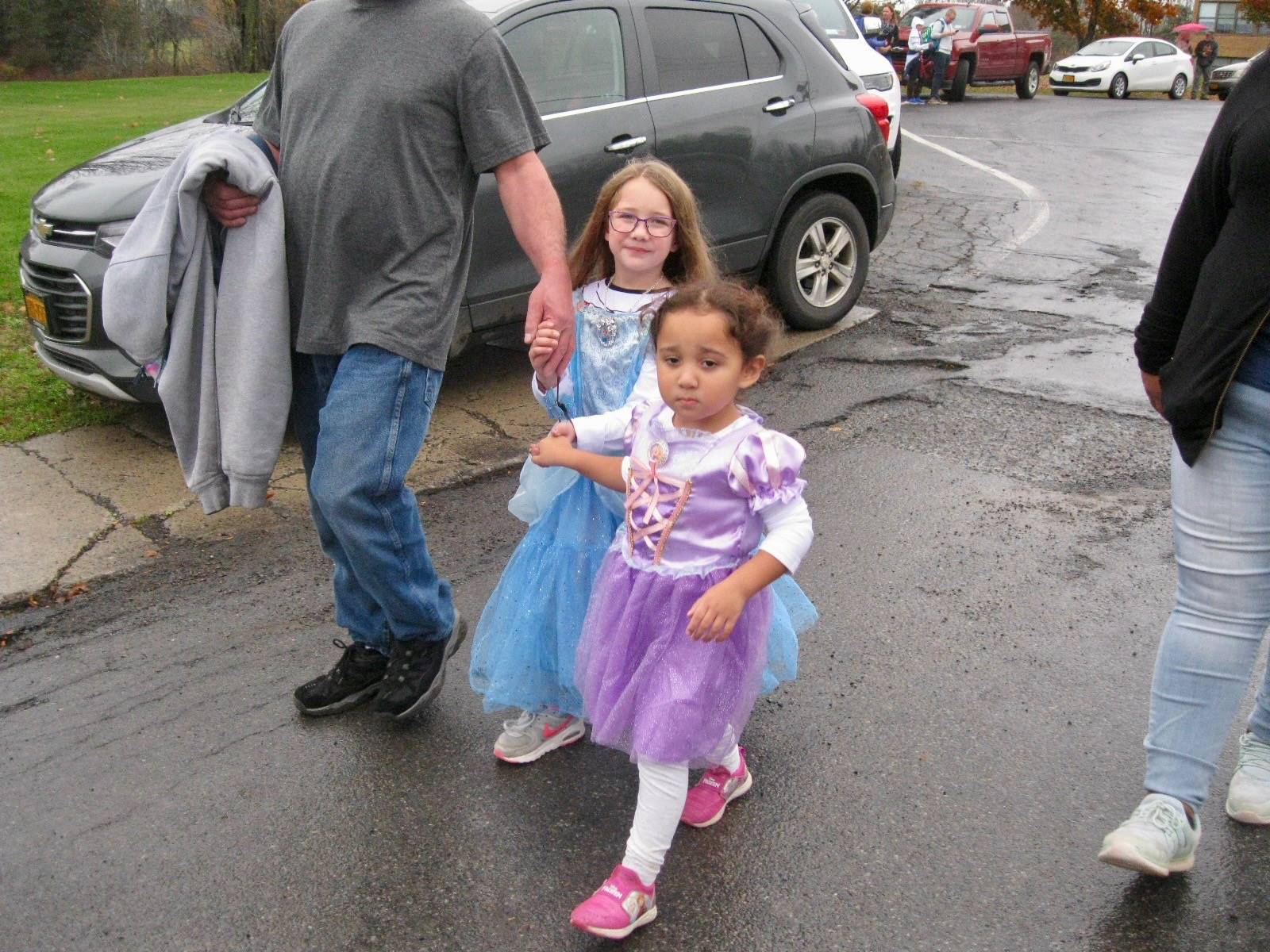 students march in halloween parade