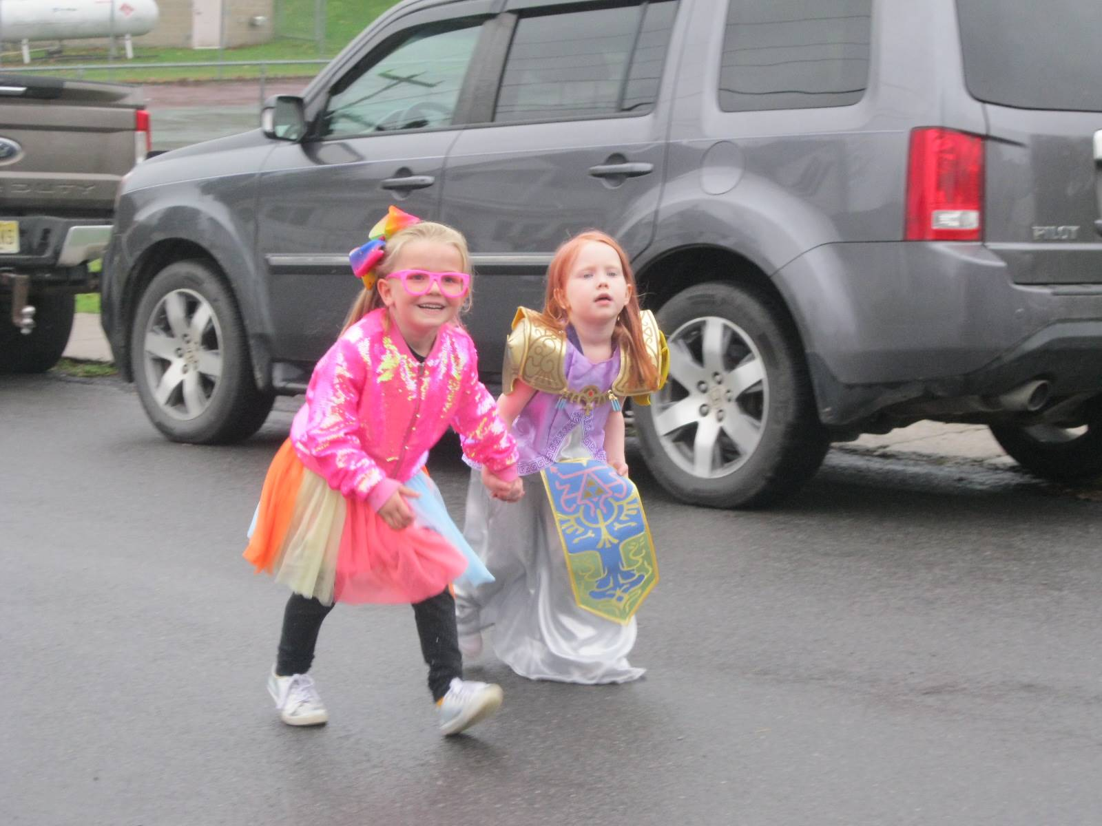 2 students march in halloween parade