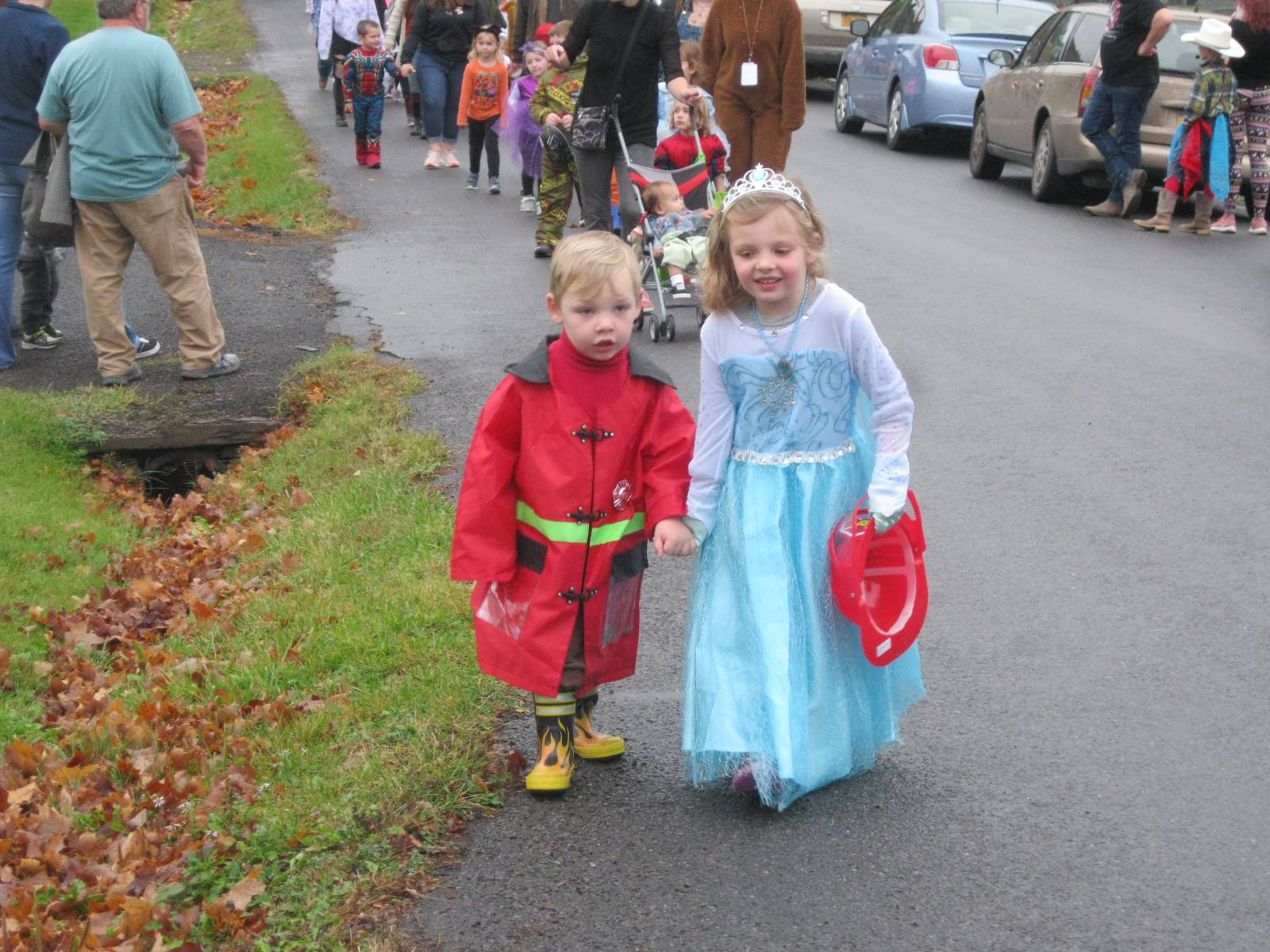 a brother and sister march in halloween parade