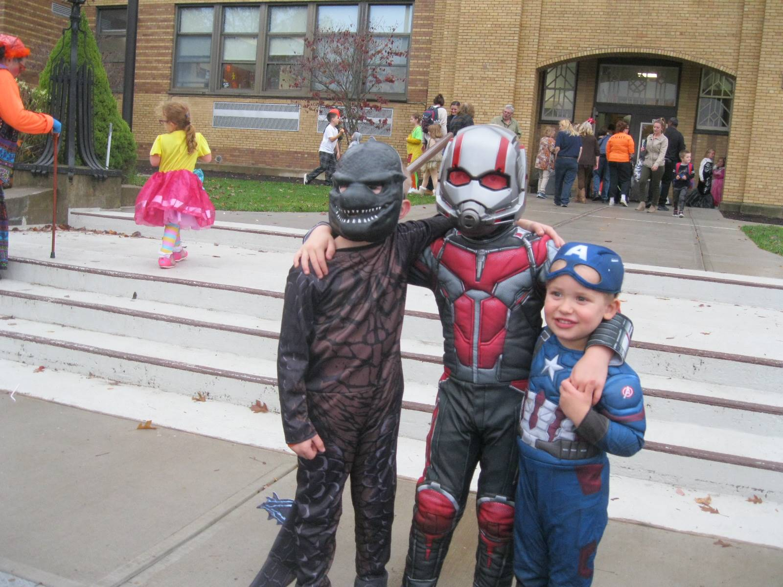 3 students in front of guilford school all dressed up.