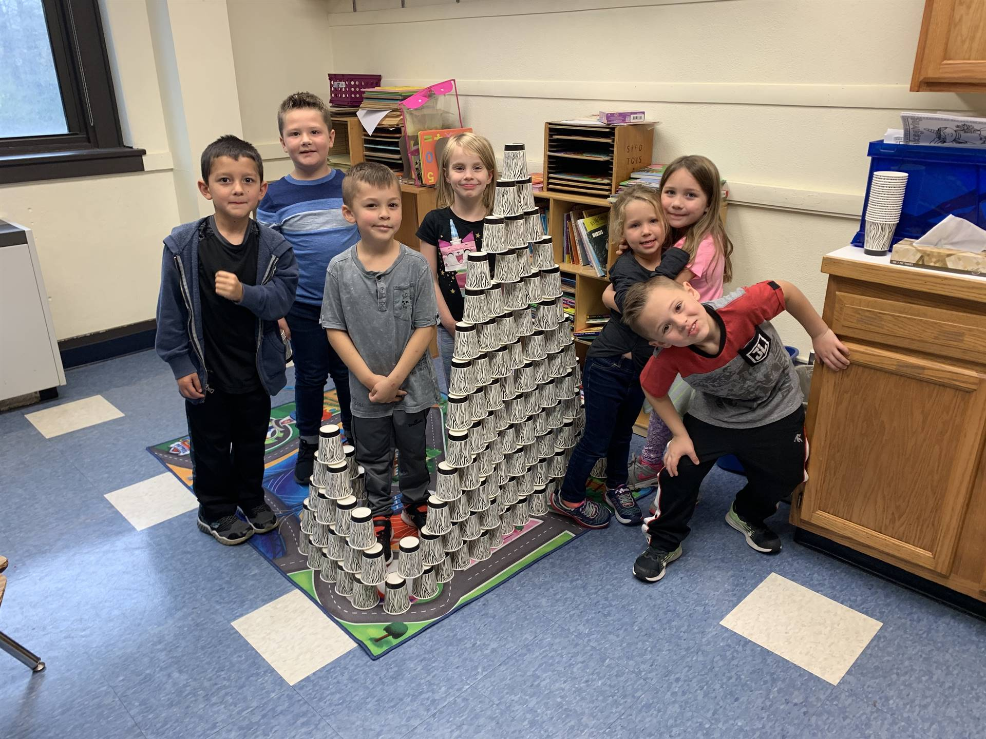 7 Students build with cups.