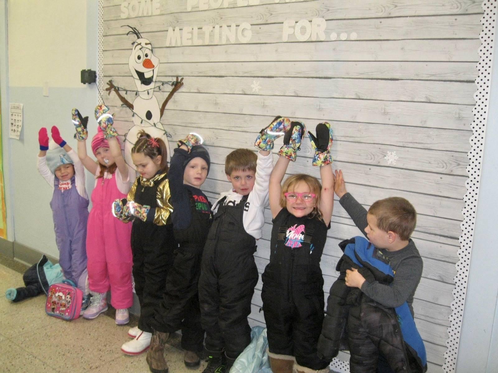 Students hold up mittens donated by Bainbridge Presbyterian Church.