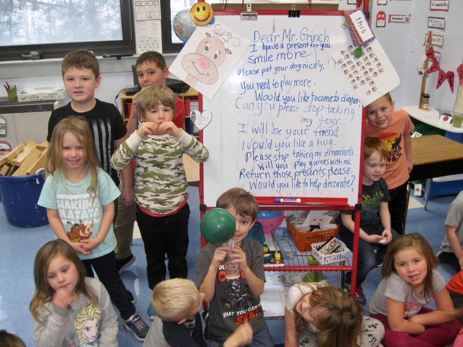 A class shows hearts in response to Mr. Grinch.