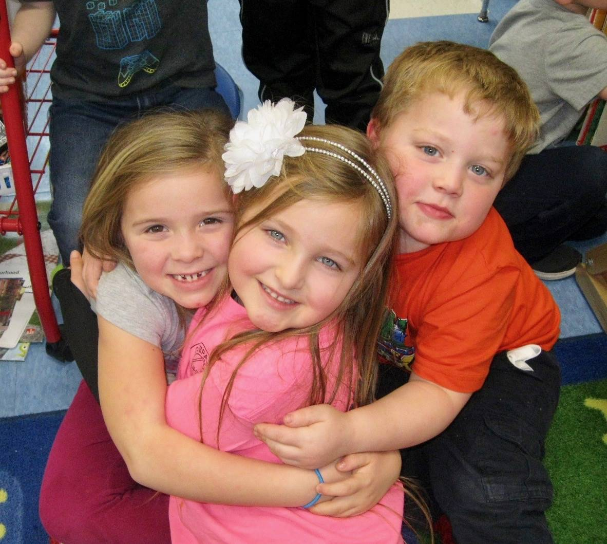 3 students show kindness to each other.