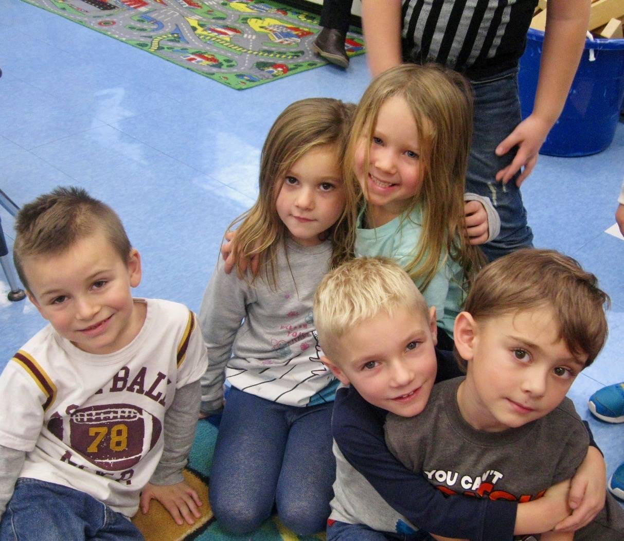 5 students show kindness to each other.