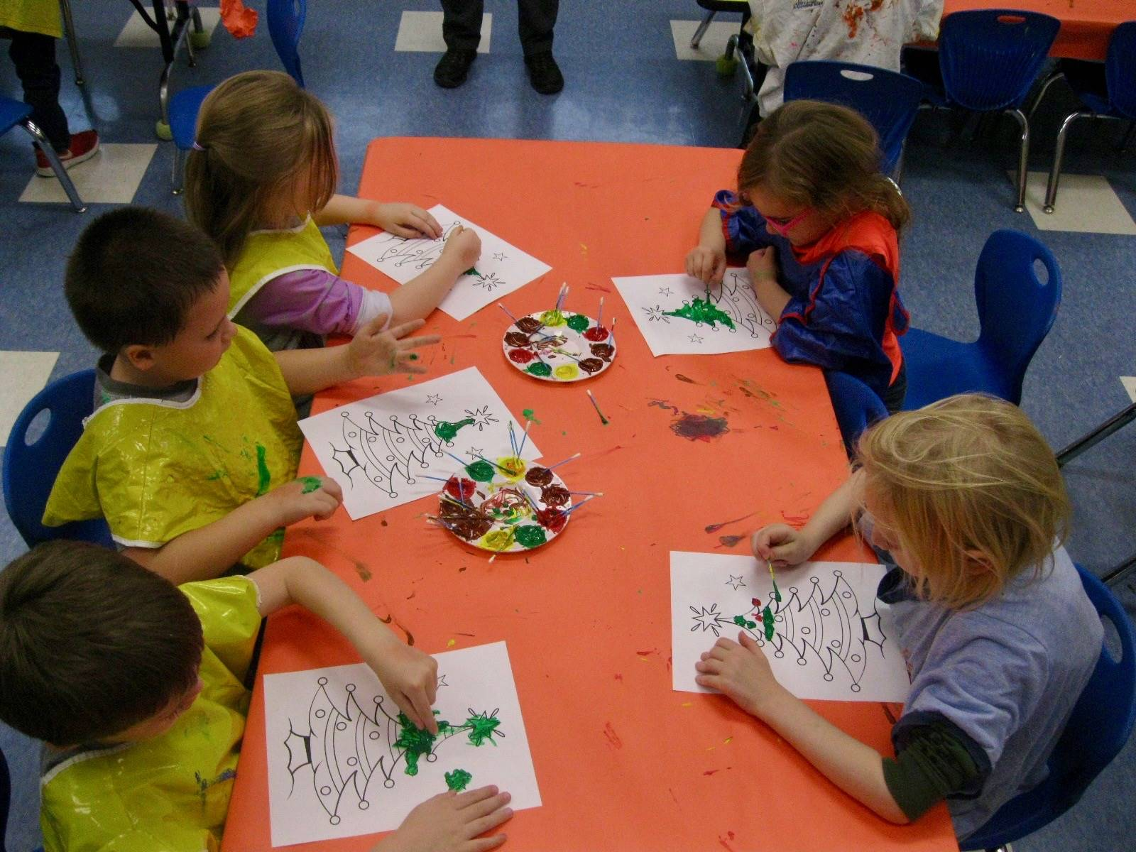 5 students paint Christmas trees.