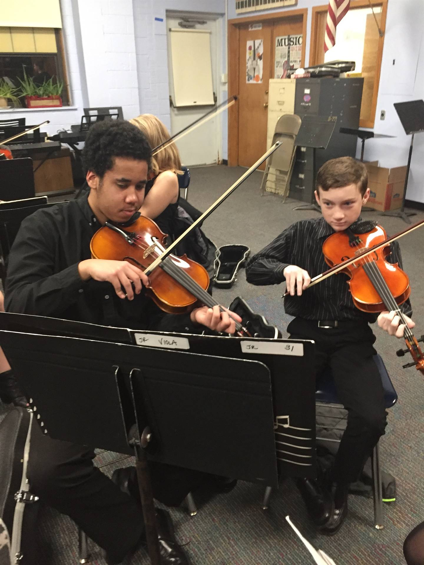 Jr High Orchestra violin players