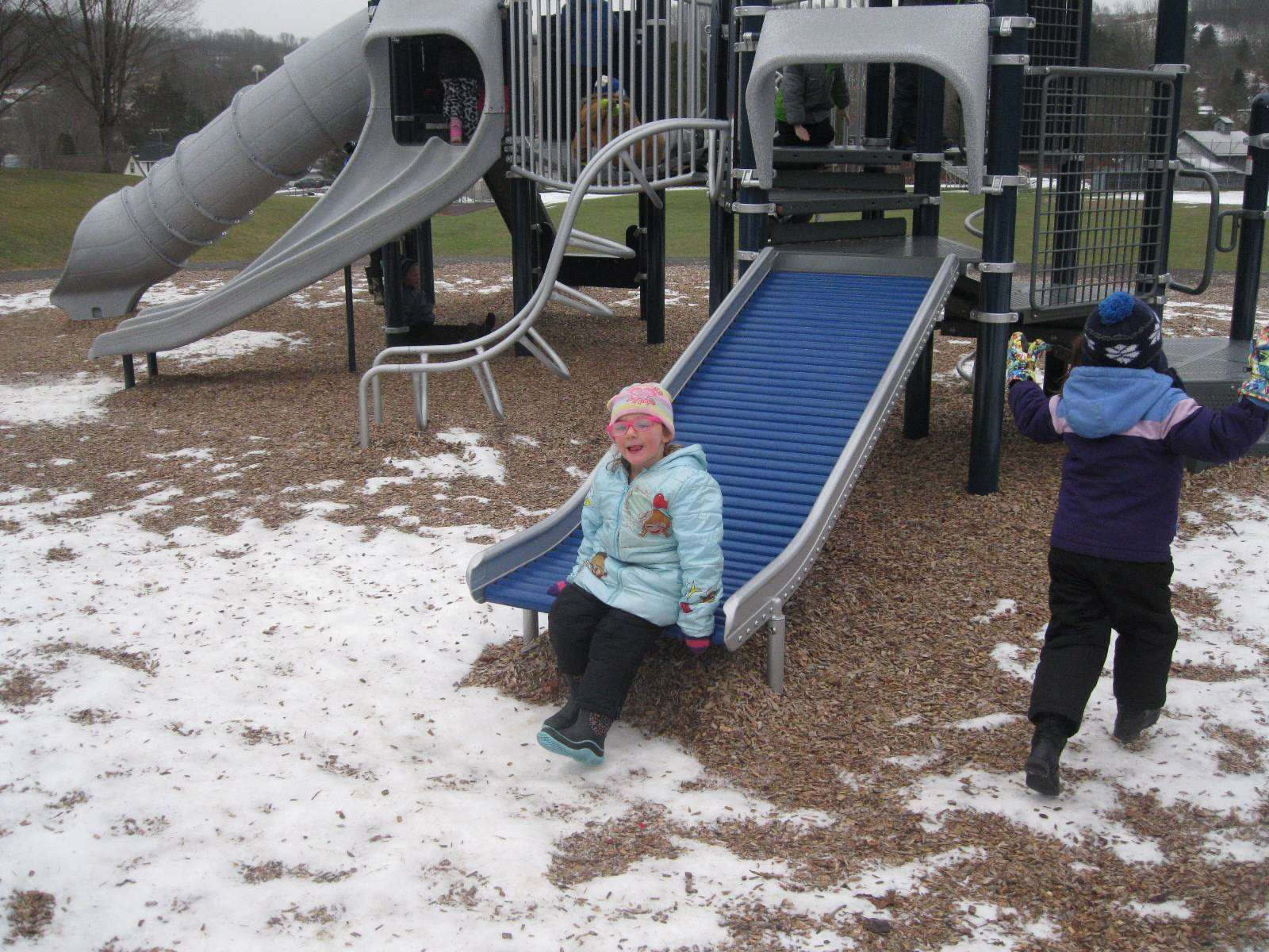 A student sits on slide.