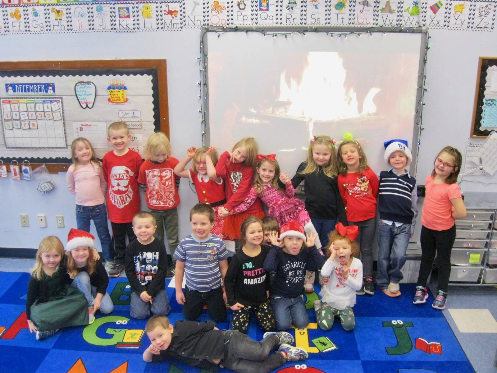 A class poses in their holiday clothes.