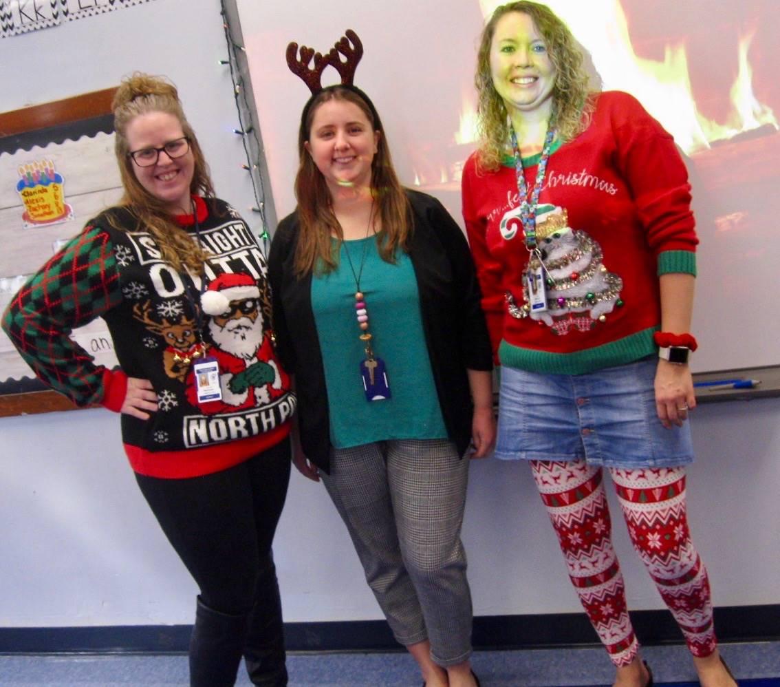 3 holly jolly staff members.