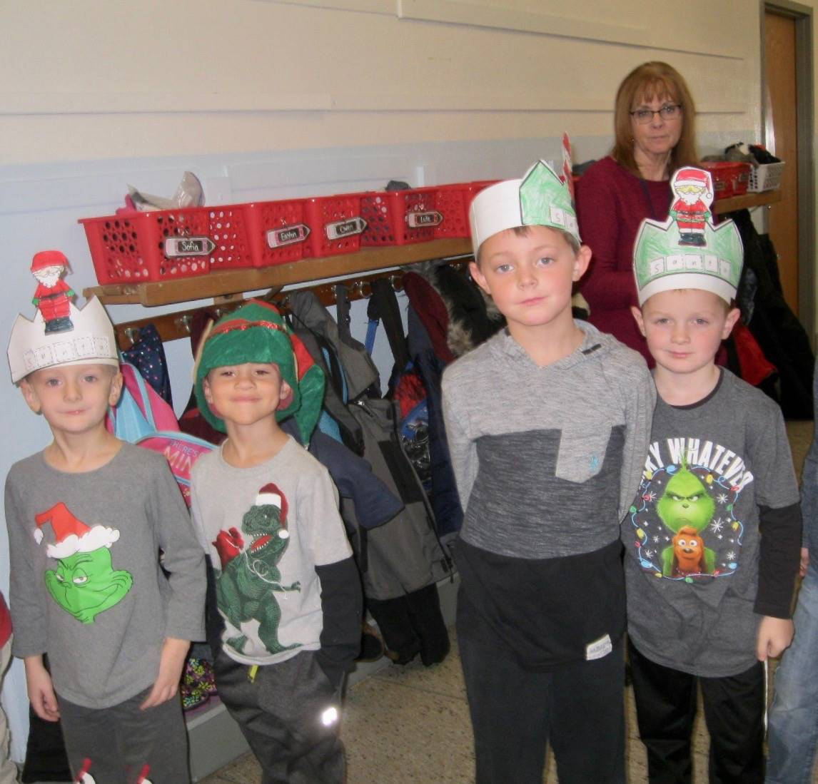 4 students in holiday hats.