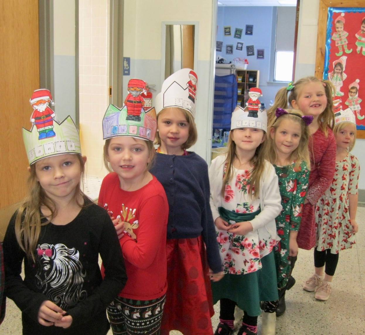 6 students in holiday hats.