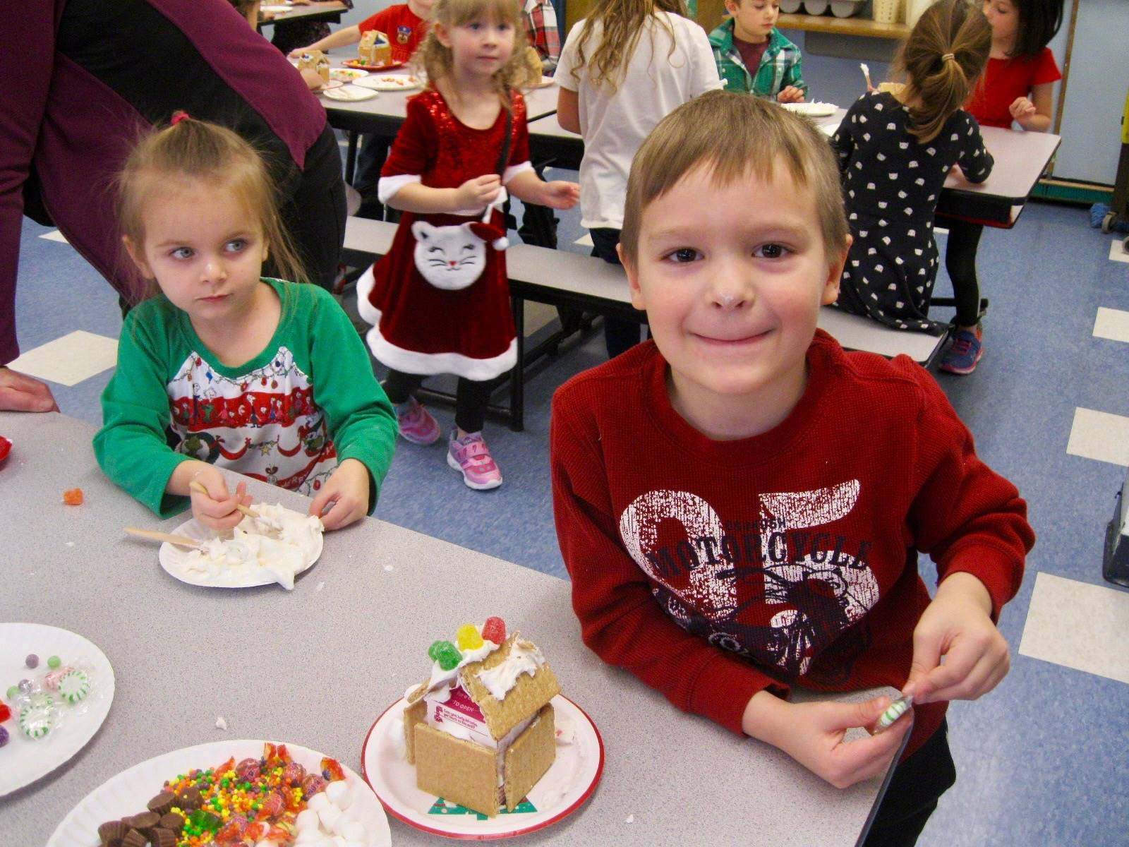 2 students with ginger bread houses.