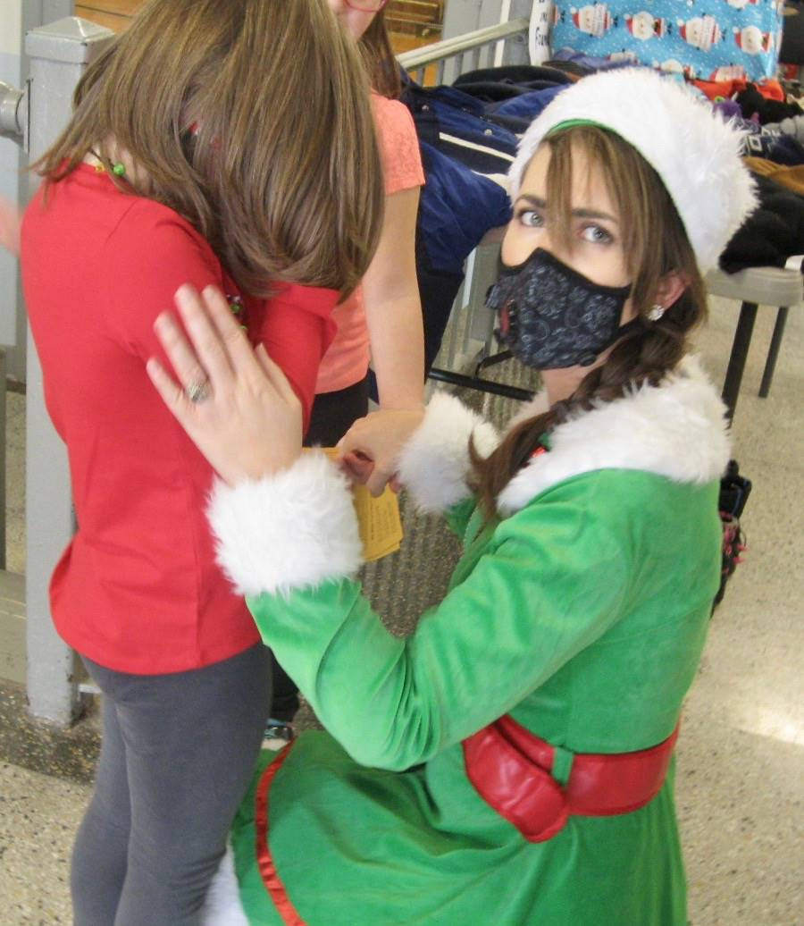 An elf comforts a student.