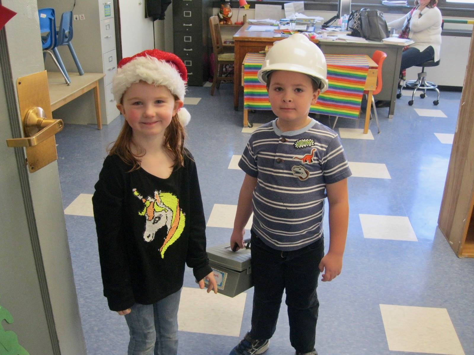 2 students with hats.