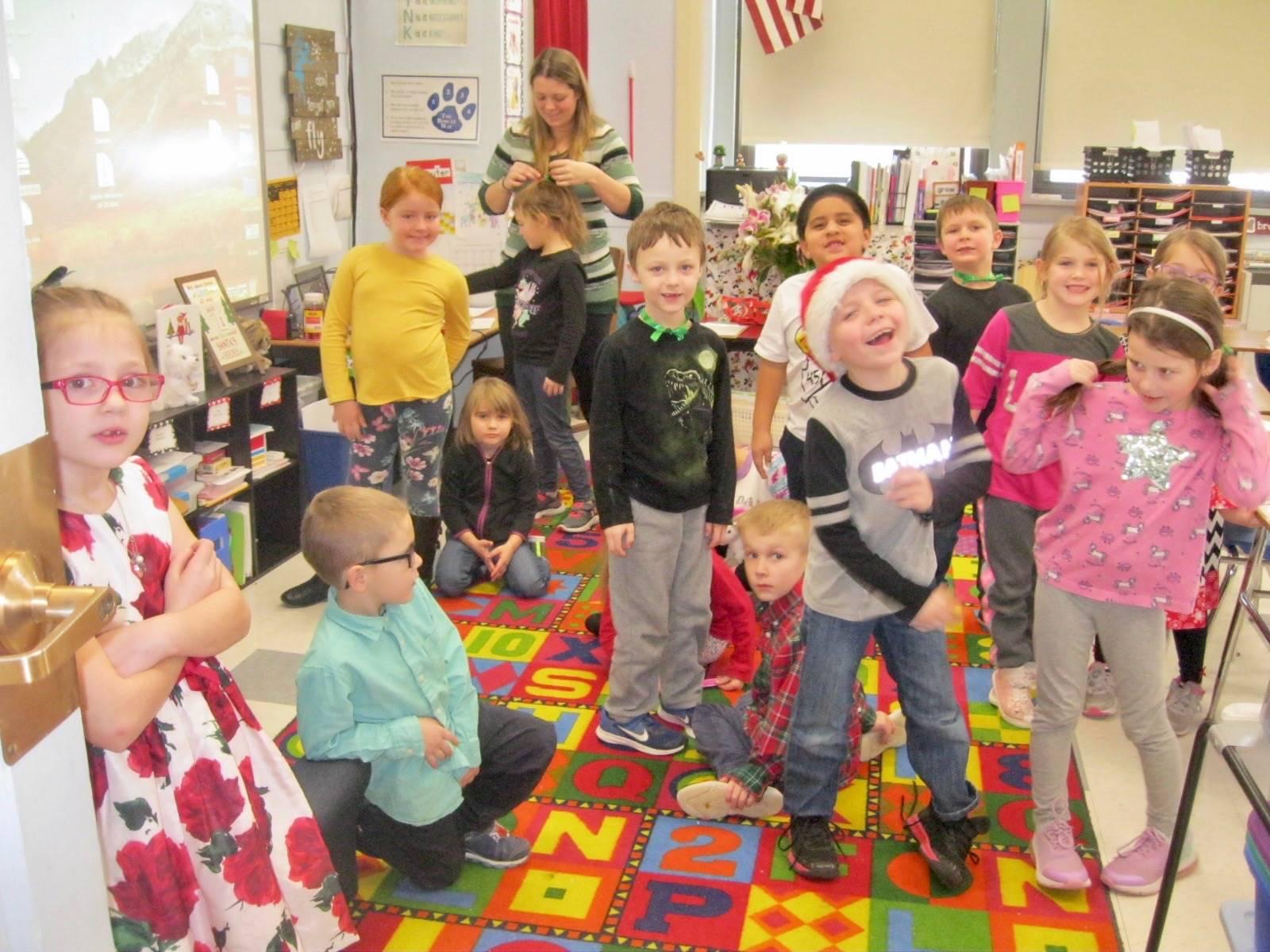 A class shows their Holiday spirit.