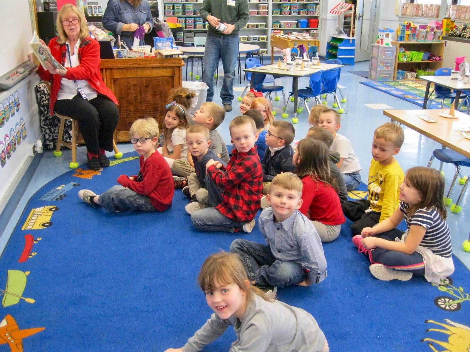 A staff member reads to children.