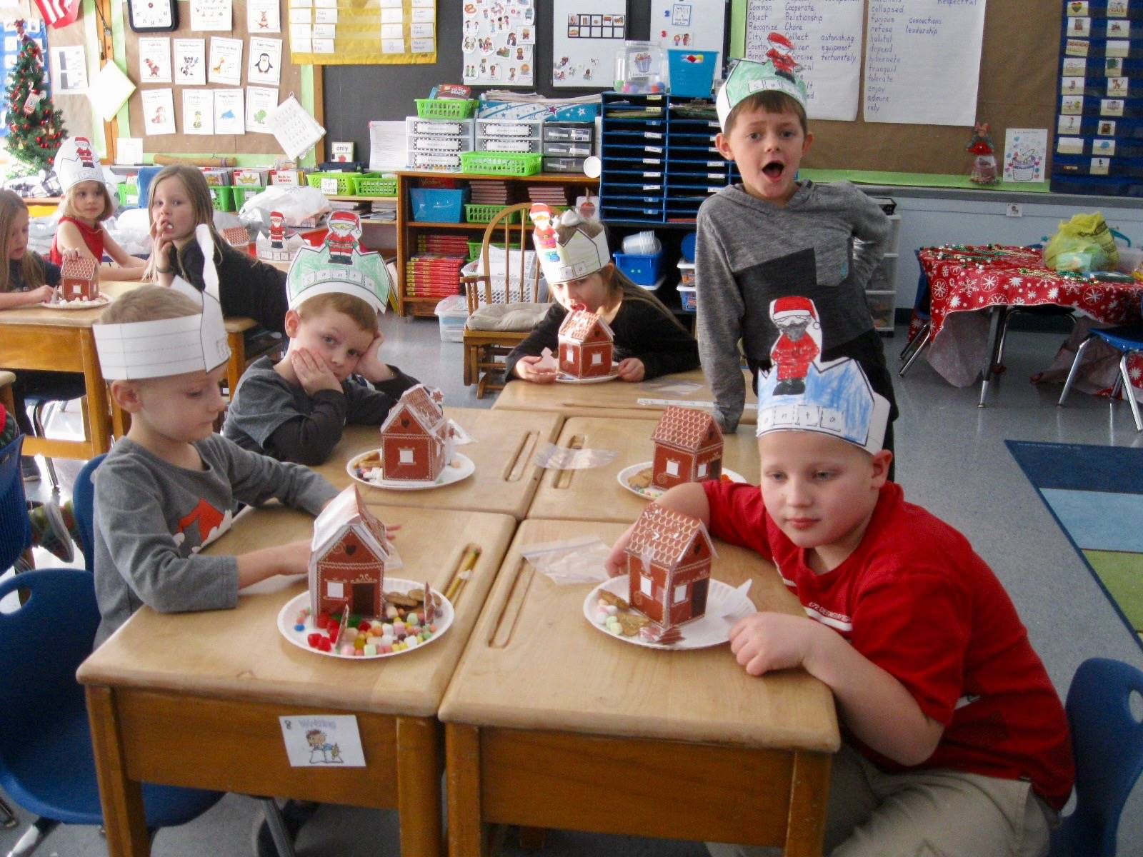 Students with gingerbread houses.