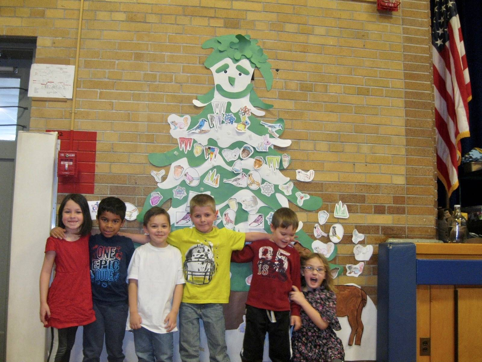 Several students by the friendship tree.