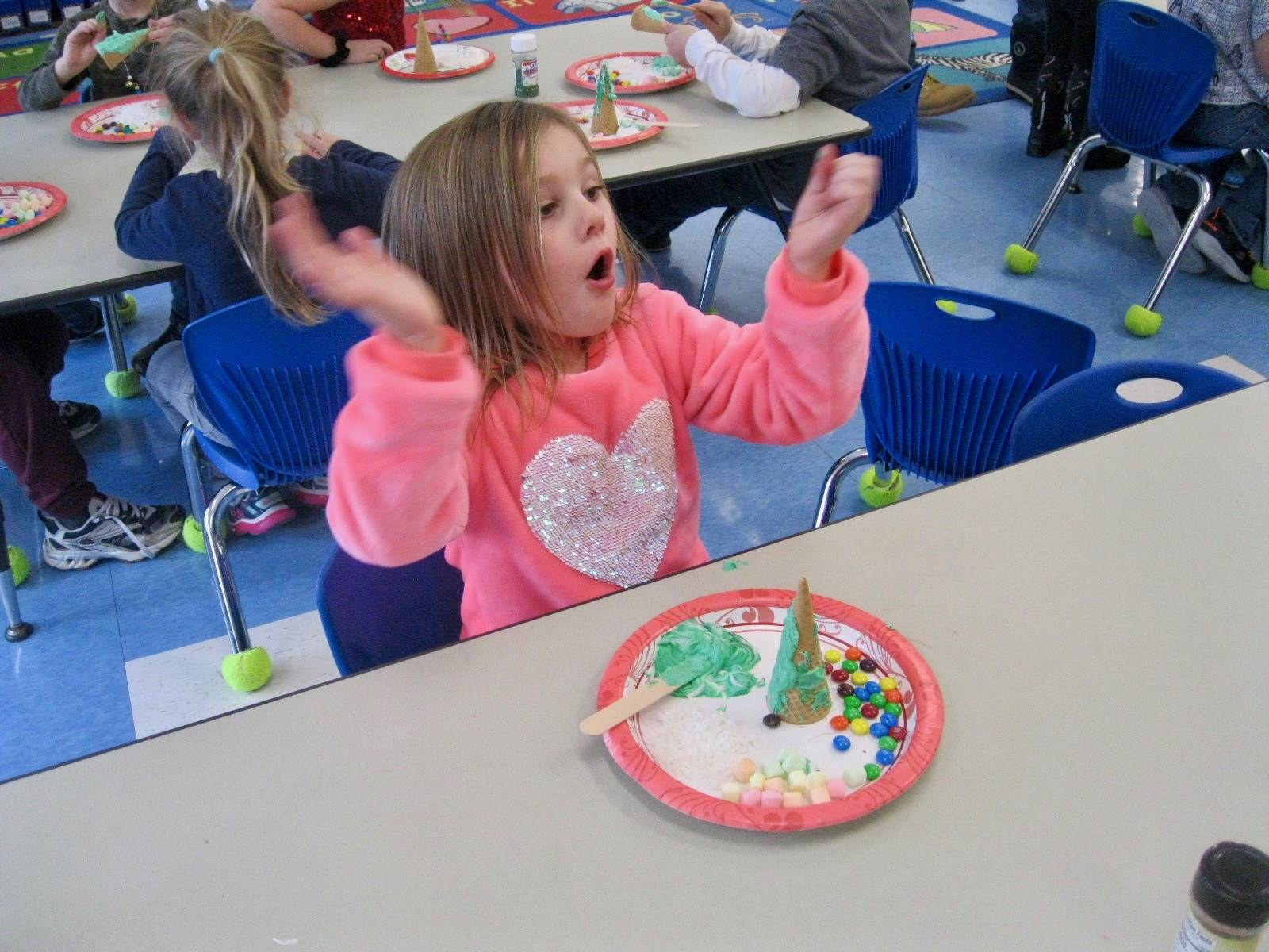 A student is excited with her frosting tree.