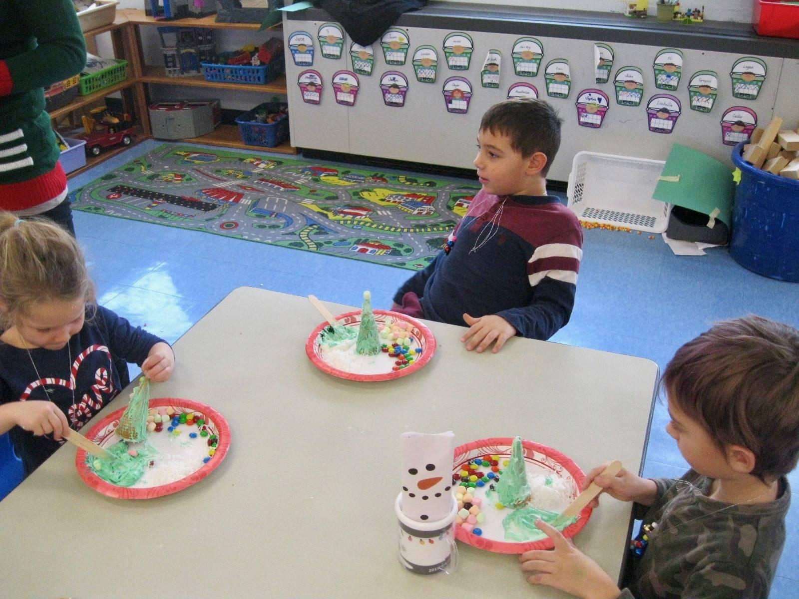 Students frost  ice-cream  cone trees.