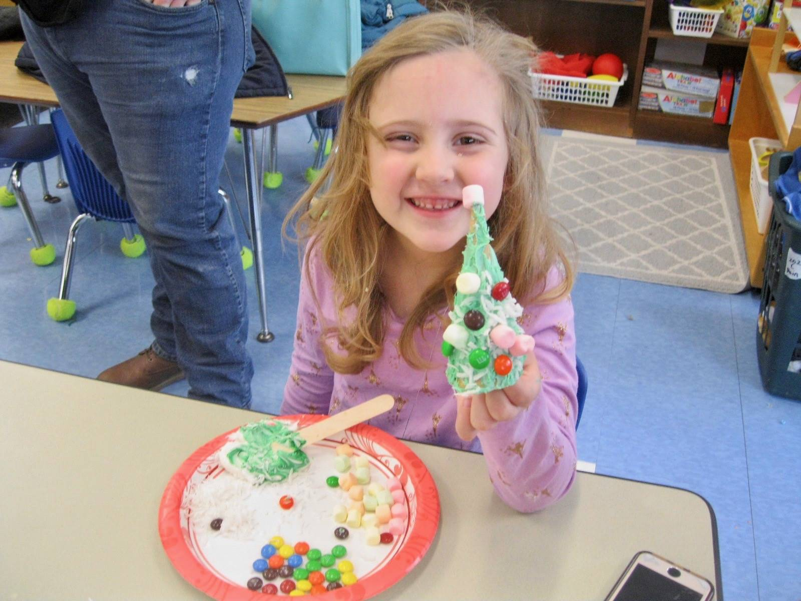 A student shows her decorated frosting tree!