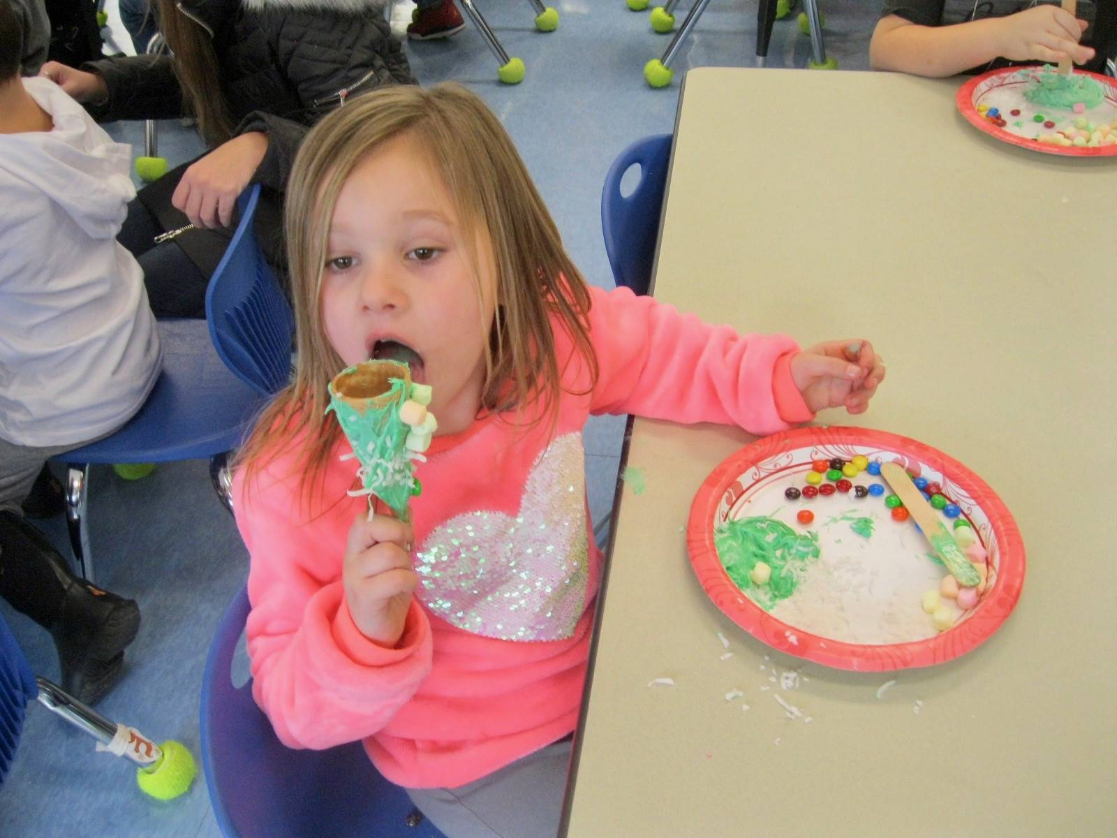 a student samples a frosting tree.
