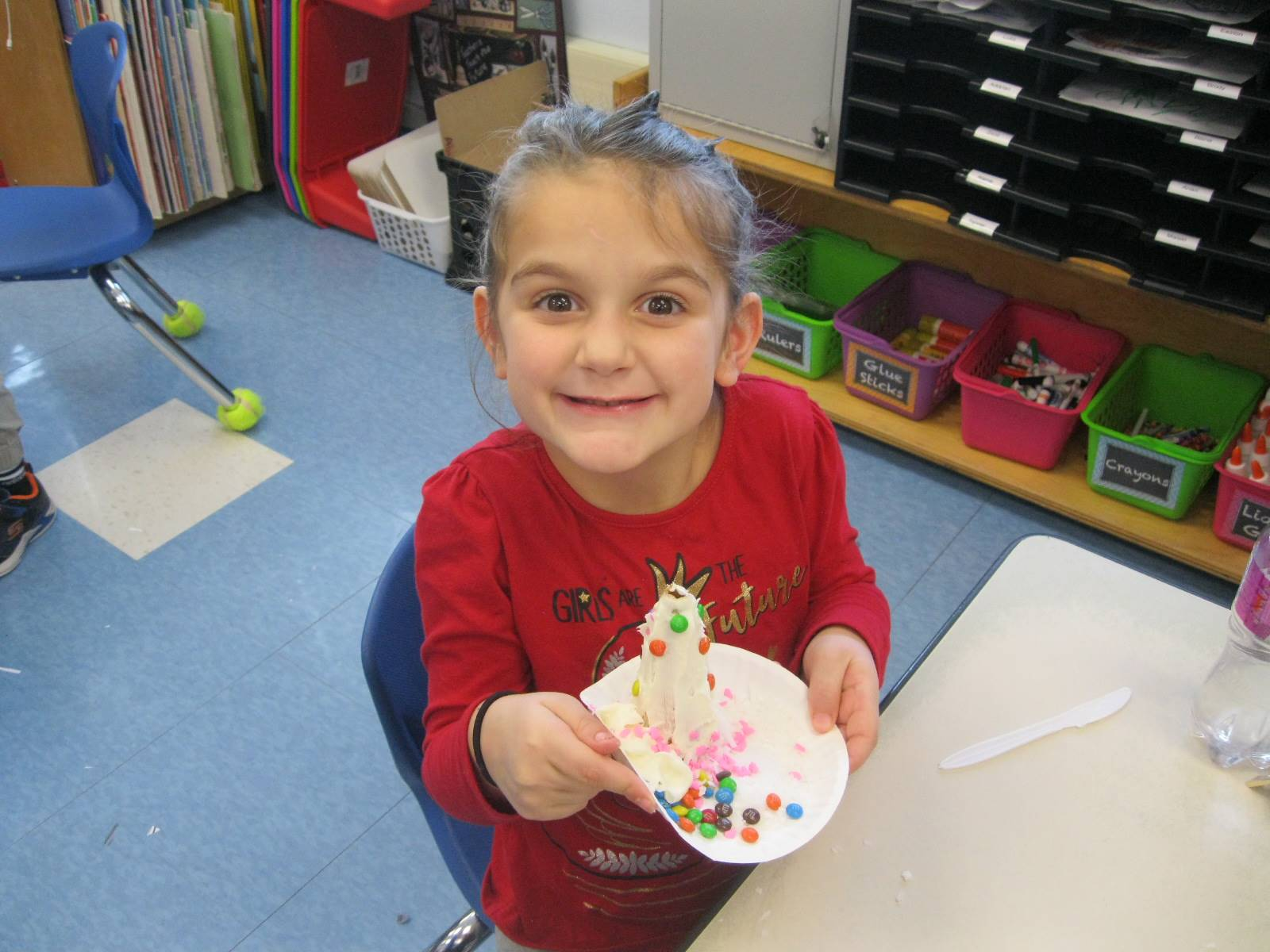 A student is proud of her snow tree!