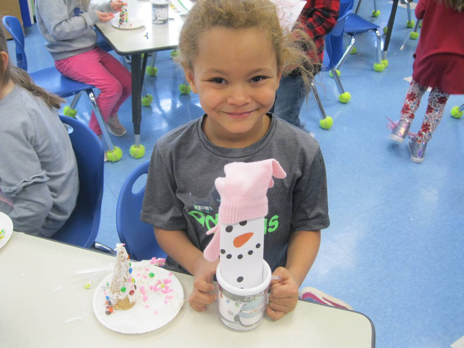 A student with a snow tree and a snow girl!