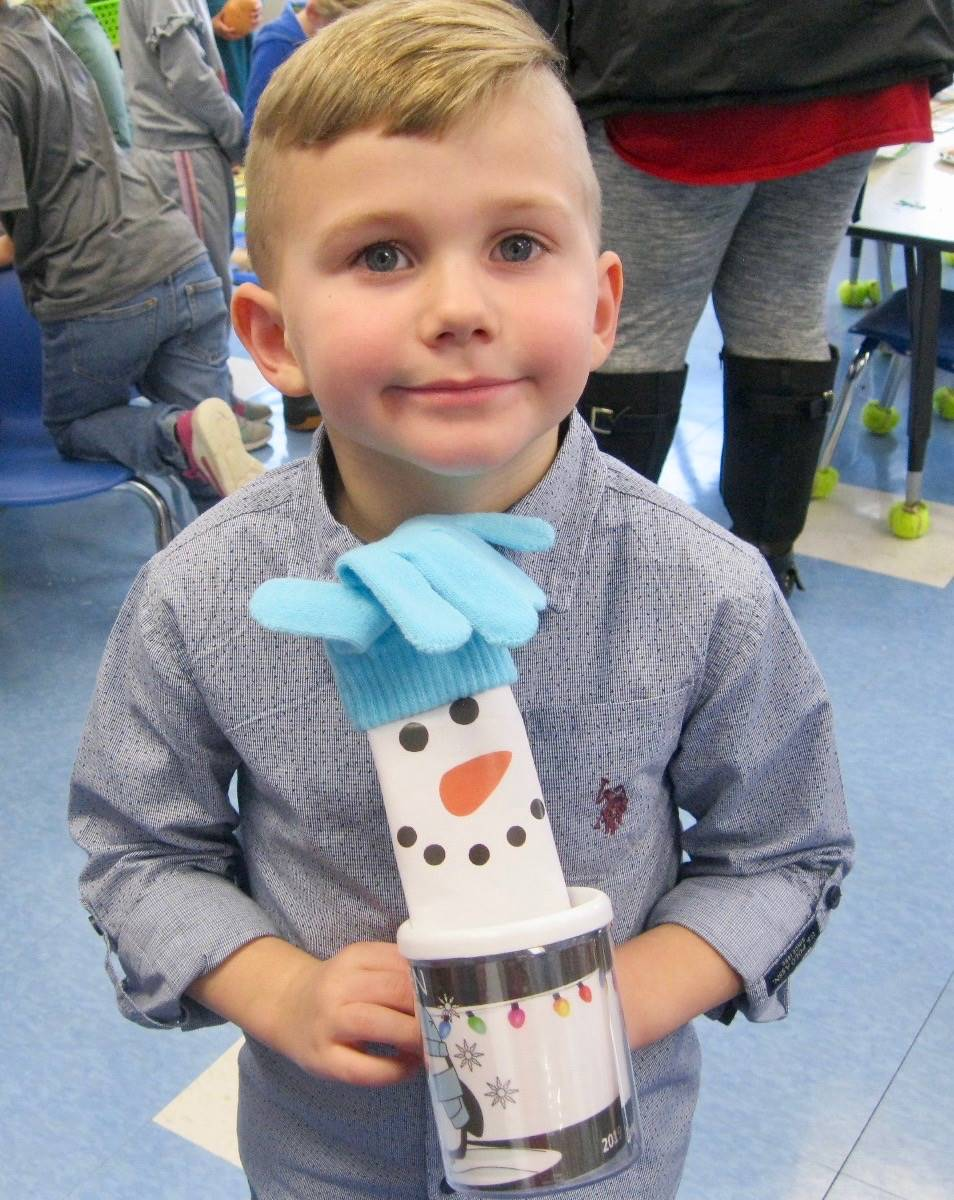 A student with his snowman present.