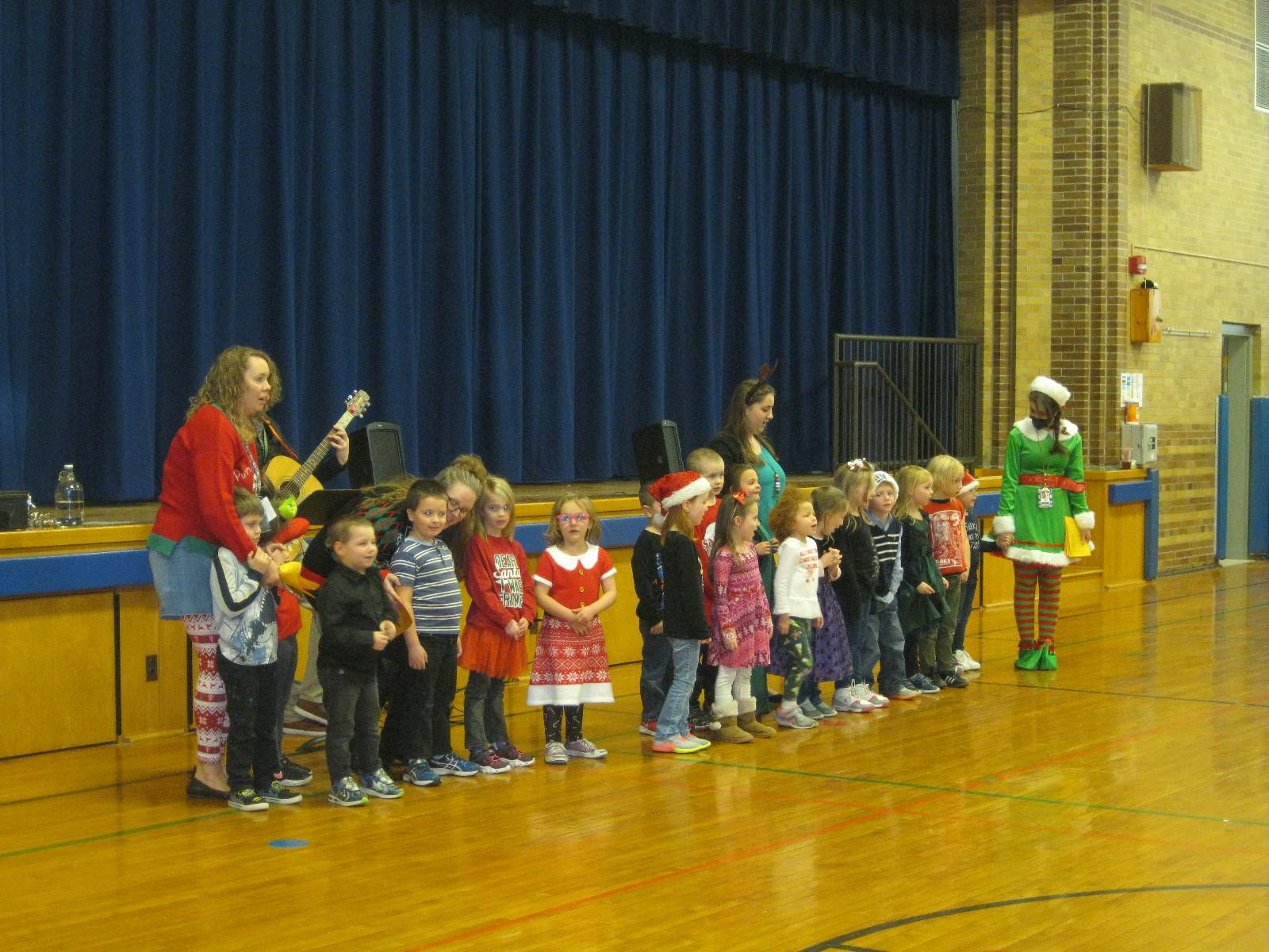 A class sings a holiday song.