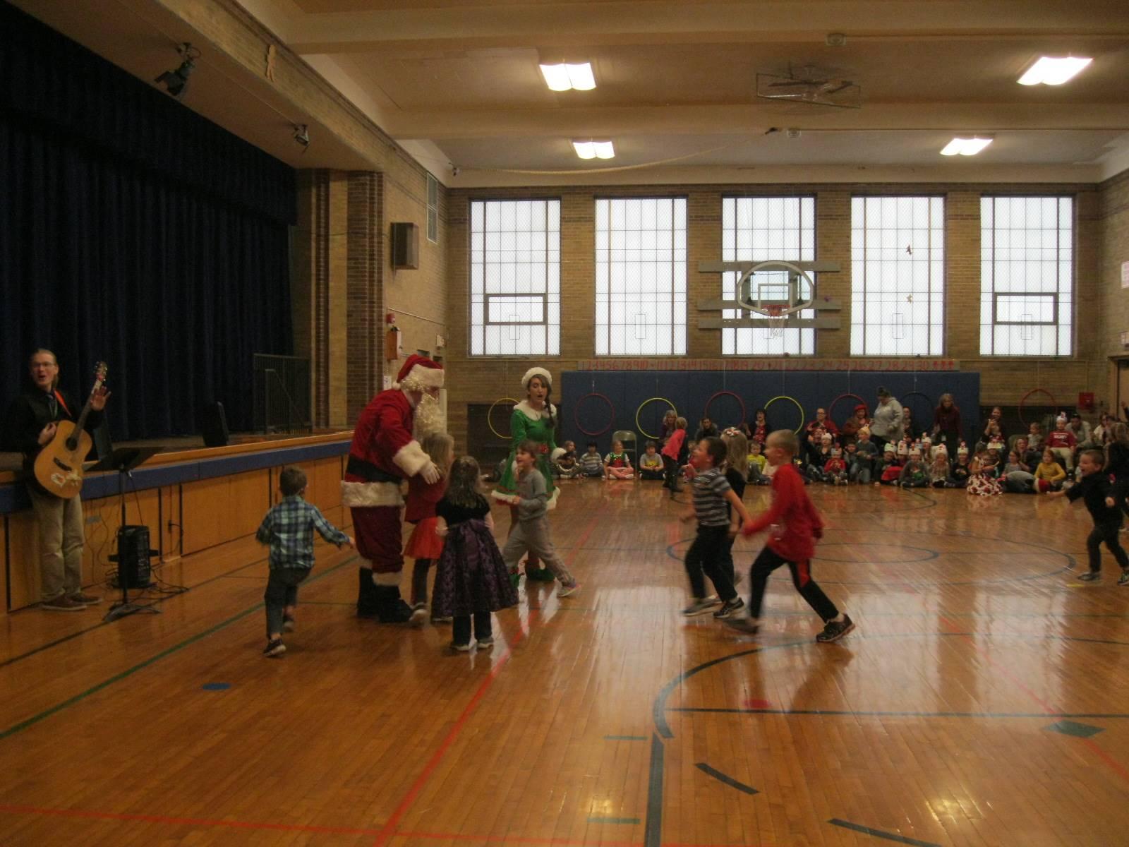 Kids run to greet Santa.
