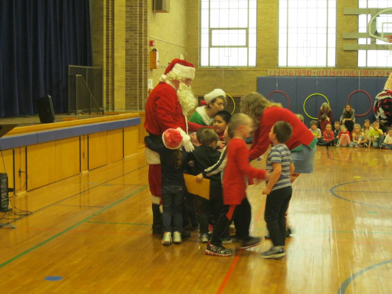 Kids hug Santa.