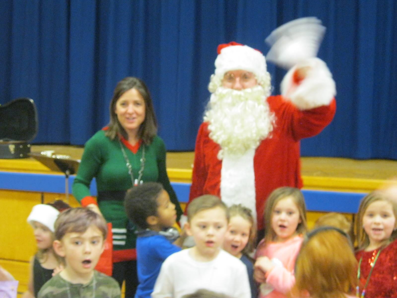 Santa and teacher with kids.