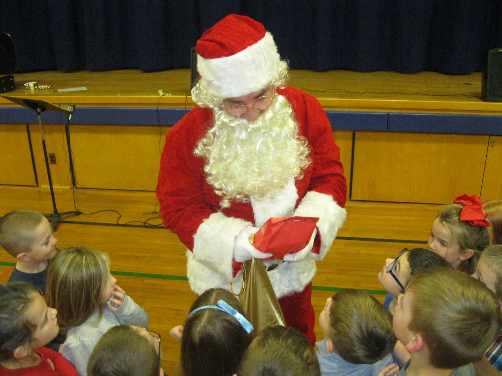 Santa winks at students.