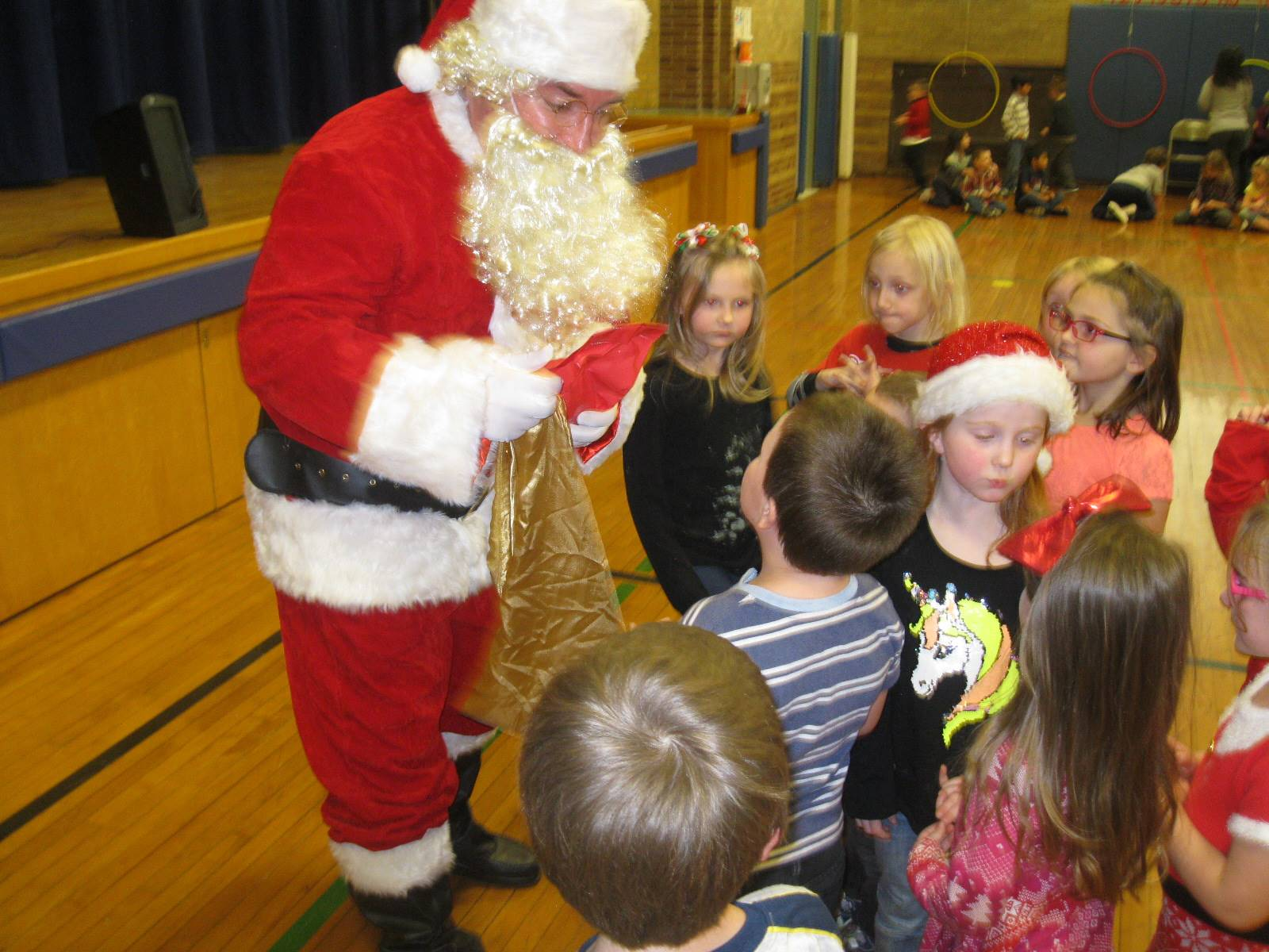 Santa listens while students ask questions.