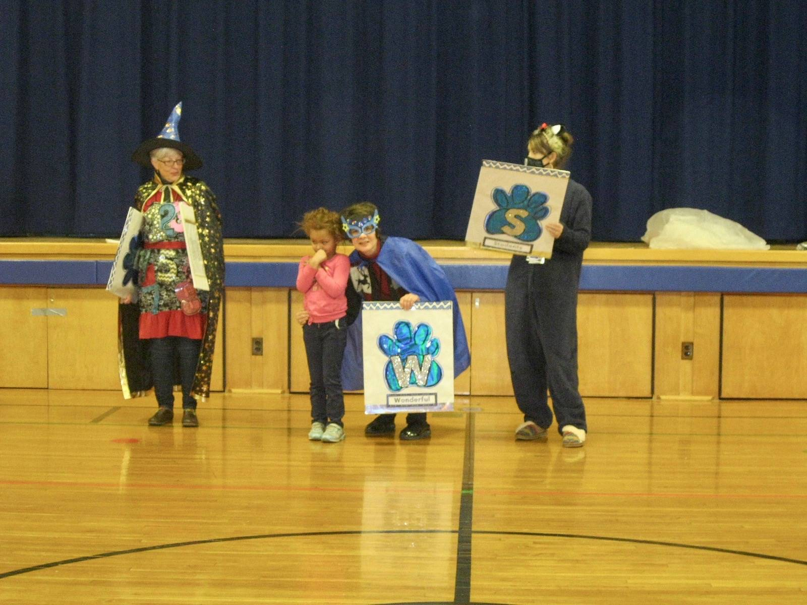 PAWS assembly with student who got a paw.