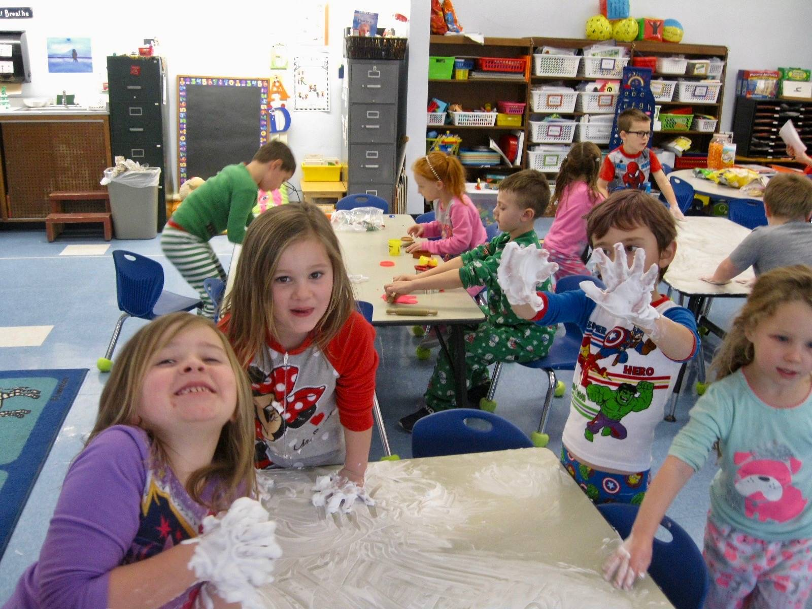 4 students show hands with shaving cream.