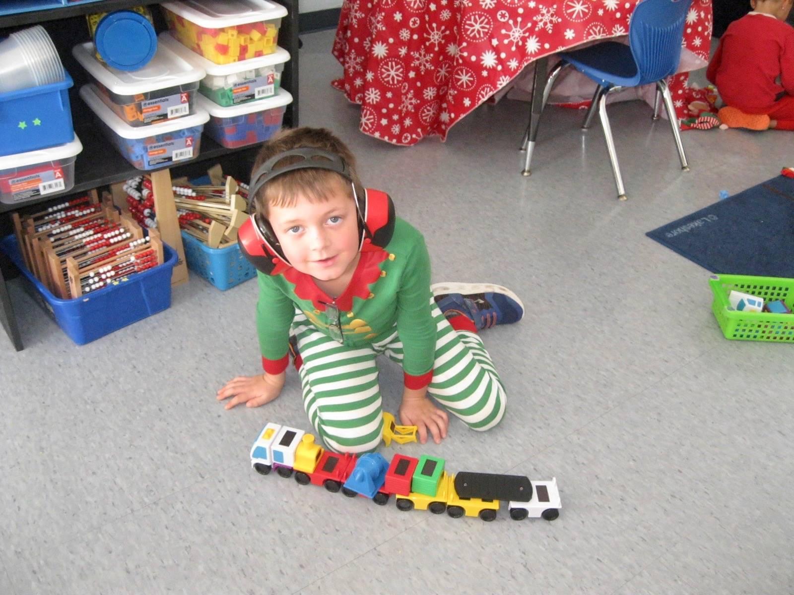 A student shows a train he built.