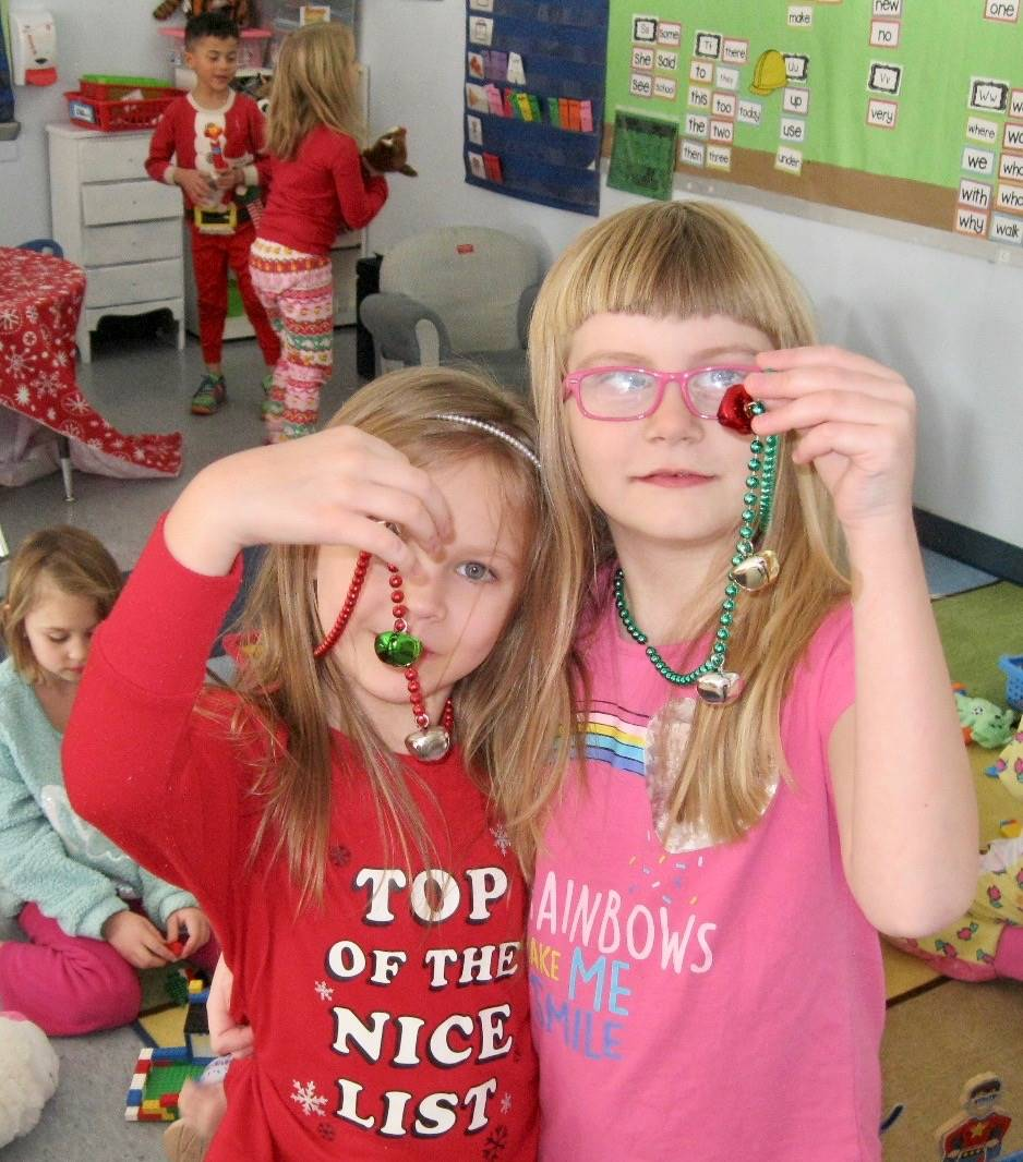 2 students with jingle bell necklaces.