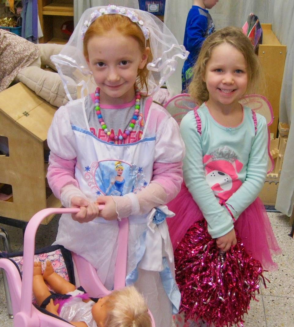 2 students in dramatic dress up play.
