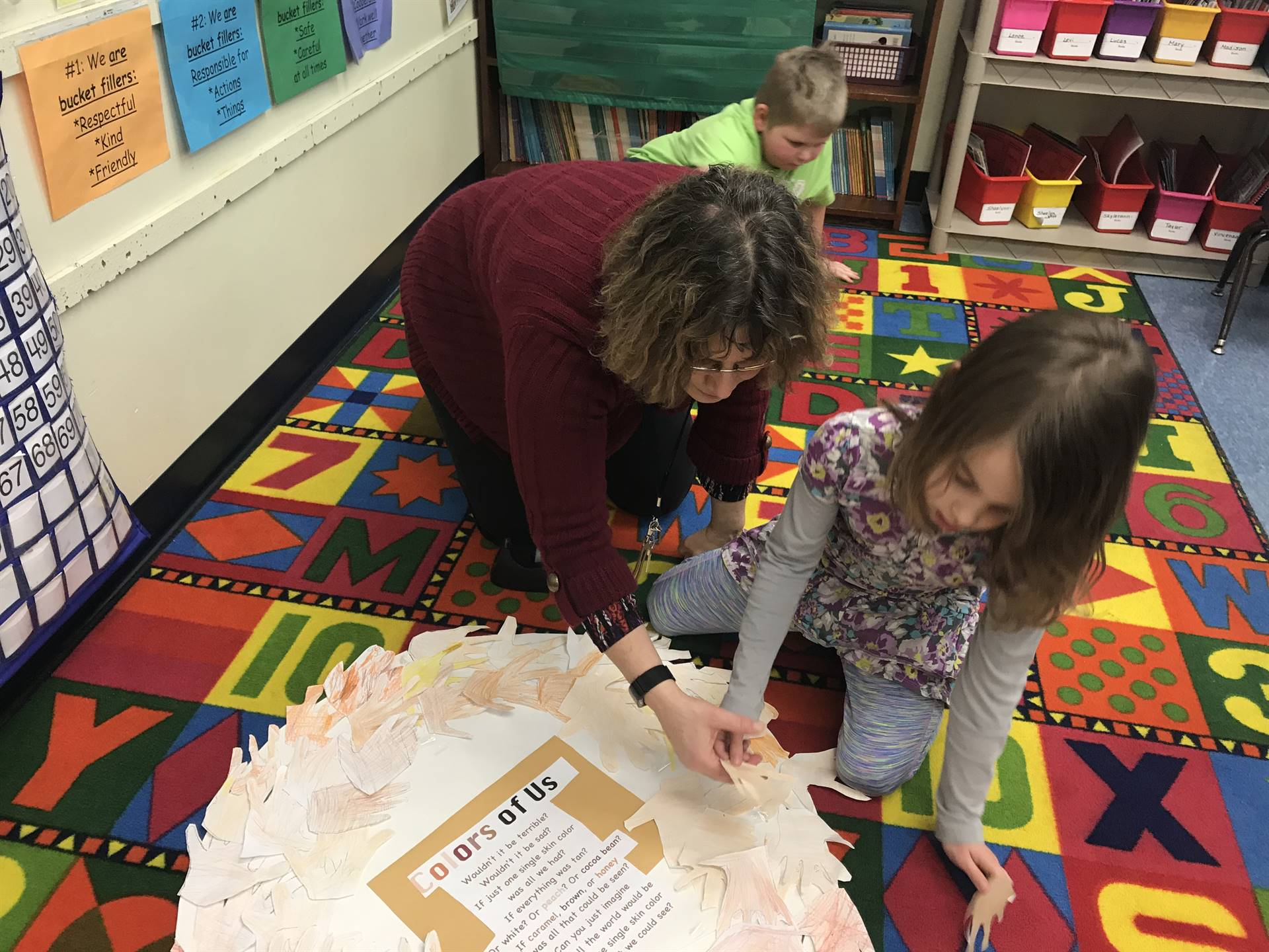 "Counselor and student assembling ""colors of us"" wreath"